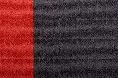Rood en zwart tapijt Stock Fotografie