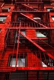 Rood Flatgebouw stock afbeeldingen