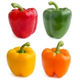 Rood, geel, oranje en groene paprika's stock afbeeldingen