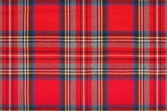 Rood geruit Schots wollen stof, geruite Schotse stoffenmacro, achtergrond Royalty-vrije Stock Foto's