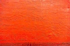 Rood geschilderd canvas met de textuur van borstelslagen Stock Foto