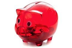 Rood glas piggybank op witte achtergrond Stock Afbeeldingen
