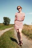 Vrouw in een weg Stock Foto