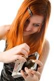 Rood haired meisje met harde aandrijving Stock Foto's