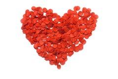 Rood hart van confettien op witte achtergrond stock afbeeldingen