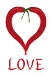 Rood hart van Spaanse peperpeper met inschrijvingsliefde Stock Afbeeldingen