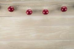 Rood Jingle Bells Against Neutral Background stock afbeeldingen
