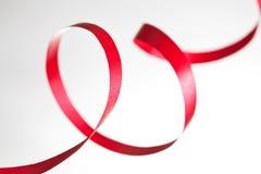 Rood lint op wit stock afbeeldingen