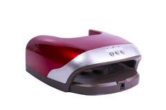Rood manicuregel die die lamp genezen op wit wordt geïsoleerd Royalty-vrije Stock Fotografie