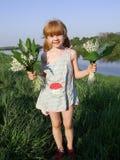 Rood meisje met een bouque Stock Foto's
