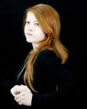 Rood meisje op zwarte Royalty-vrije Stock Foto's