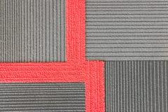 Rood met grijs tapijt Stock Fotografie