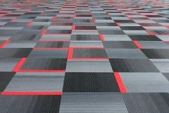 Rood met grijs tapijt Stock Foto's