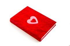 Rood notitieboekje en roze hart Stock Afbeelding
