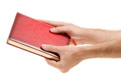 Rood notitieboekje in mannelijke handen Royalty-vrije Stock Foto's