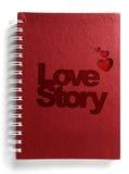Rood notitieboekje met het verhaal van de tekstliefde Stock Afbeelding