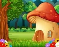 Rood paddestoelhuis op bos Stock Afbeeldingen