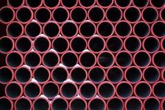 Rood pijpenpatroon stock foto's