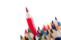 Rood potlood - de leider Stock Afbeeldingen