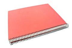 Rood spiraalvormig notitieboekje Stock Fotografie