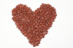 Rood suikergoed in geïsoleerdee hartvorm Royalty-vrije Stock Foto