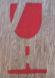 Rood symbool op triplex stock afbeeldingen