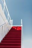 Rood tapijt aan de hemel Stock Afbeelding