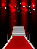 Rood tapijt met treden Stock Afbeelding