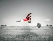 Rood uitstekend vliegtuig Stock Afbeeldingen