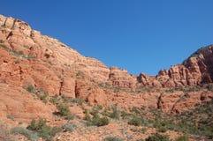 Rood zandsteenheuvels en vallei in U S Zuidwesten in natuurlijk licht stock afbeeldingen