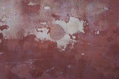 Roodachtige muur met witte huiden royalty-vrije stock foto
