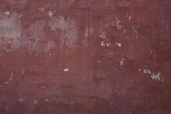 Roodachtige muur met witte huiden royalty-vrije stock afbeeldingen