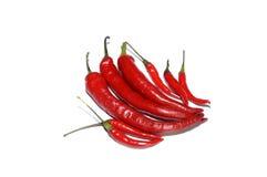 Roodgloeiende die Spaanse pepers op wit worden geïsoleerd stock afbeeldingen