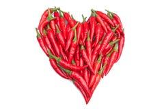 Roodgloeiende Spaanse peperpeper in een hartvorm Stock Foto