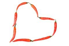 Roodgloeiende Spaanse peperspeper in hartvorm Royalty-vrije Stock Afbeeldingen