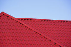 Roof. Tiles in red on a new building Stock Photo