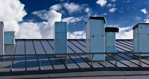 The Roof. The view of the neighboring roof with ventilation tubes Stock Photos