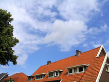 Roof. Orange roof and clouded blue sky Royalty Free Stock Photography