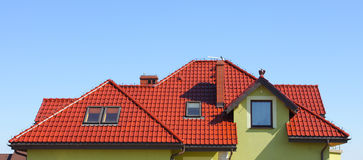 Roof. Modern tiles roof against the sky royalty free stock photography