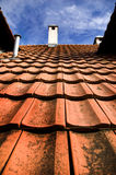 Roof. Red Roof of a brick house stock photos