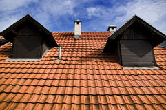 Roof. Red Roof of a brick house stock image