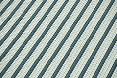 The Roof. An angled green aluminum roof background image Royalty Free Stock Photo