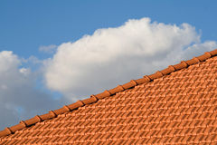 Roof. Tiles and sky with clouds Royalty Free Stock Photo