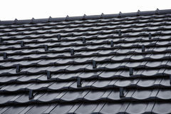 Roof. Black roof on a house Royalty Free Stock Photo