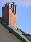 Roof. Modern house's roof with chimney Royalty Free Stock Photos