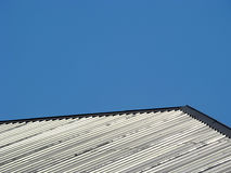 Roof. Modern build materials. Metallic roof on a background of  blue sky. Space for text Royalty Free Stock Images