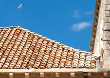 Roof. Tile roof isolated on a background of blue sky royalty free stock photo