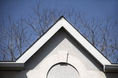 Roof. High pitched roof with arched molding royalty free stock image