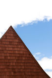 Roof. Angled roof against cloudy sky royalty free stock image