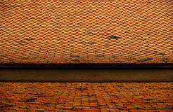 Roof. A pattern of tiles on an old, weathered terracotta roof Stock Photos